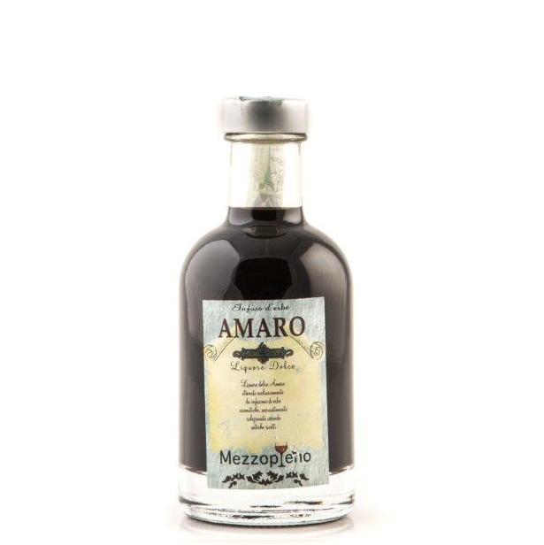 Amaro - Infuso di Erbe aromatiche selezionate secondo antica ricetta. 0.50 cl. - 30° disponibile anche nel formato 0.20 cl.